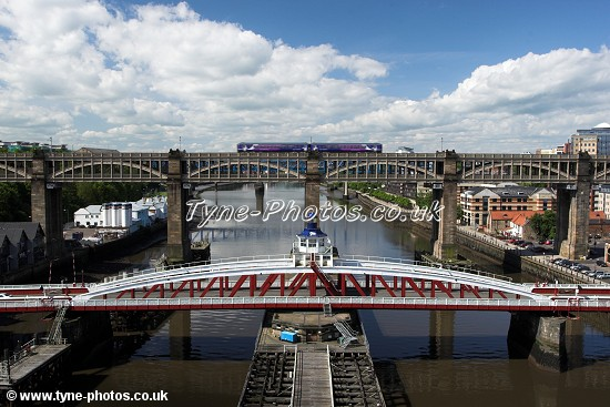 View from the middle of the Tyne Bridge towards the Swing Bridge and High Level Bridge.