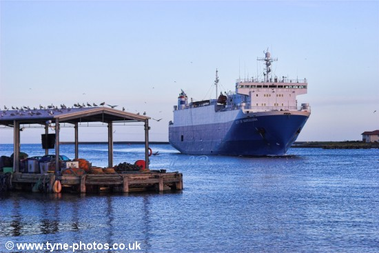 Car carrier City of Barcelona arriving in the River Tyne and passing North Shields Fish Quay.