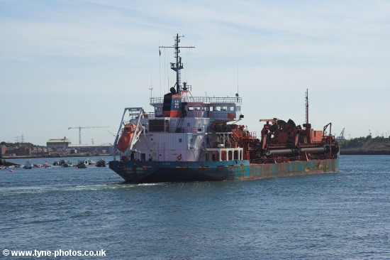 Dredger Arco Humber passing North Shields Fish Quay.
