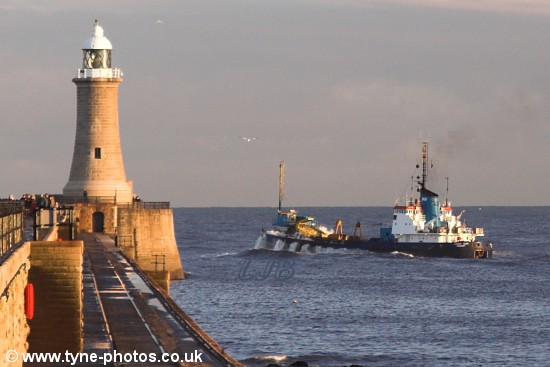 Dredger Cherry Sand pitching as it passed the lighthouse.