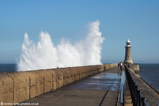 Waves breaking over Tynemouth Pier.