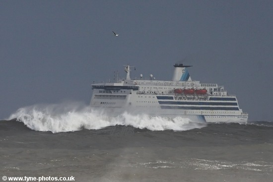 Car and Passenger Ferry, King of Scandinavia, approaching the River Tyne in rough seas.