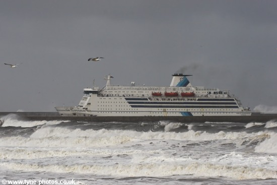 Car and Passenger Ferry, King of Scandinavia, entering the River Tyne in rough seas.