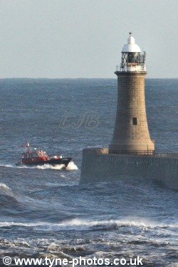 Tyne Pilot Boat Norman Forster riding the waves past Tynemouth Lighthouse.